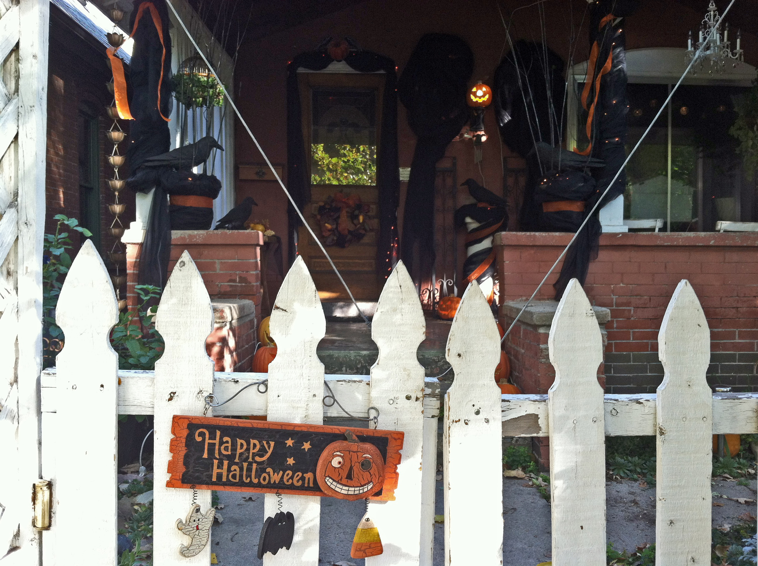 the front gate the 2 pots are changed out every season this year i simply added fake fall foliage and my beloved crow decoys all my fall foliage was been